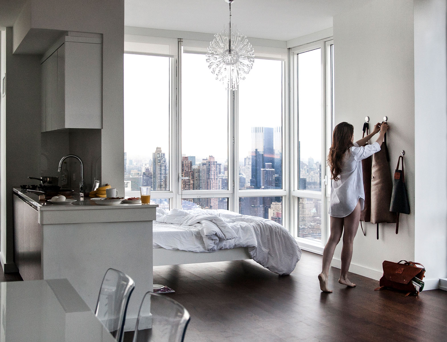 WITLOFT Penthouse in NYC Story woman hanging the aprons