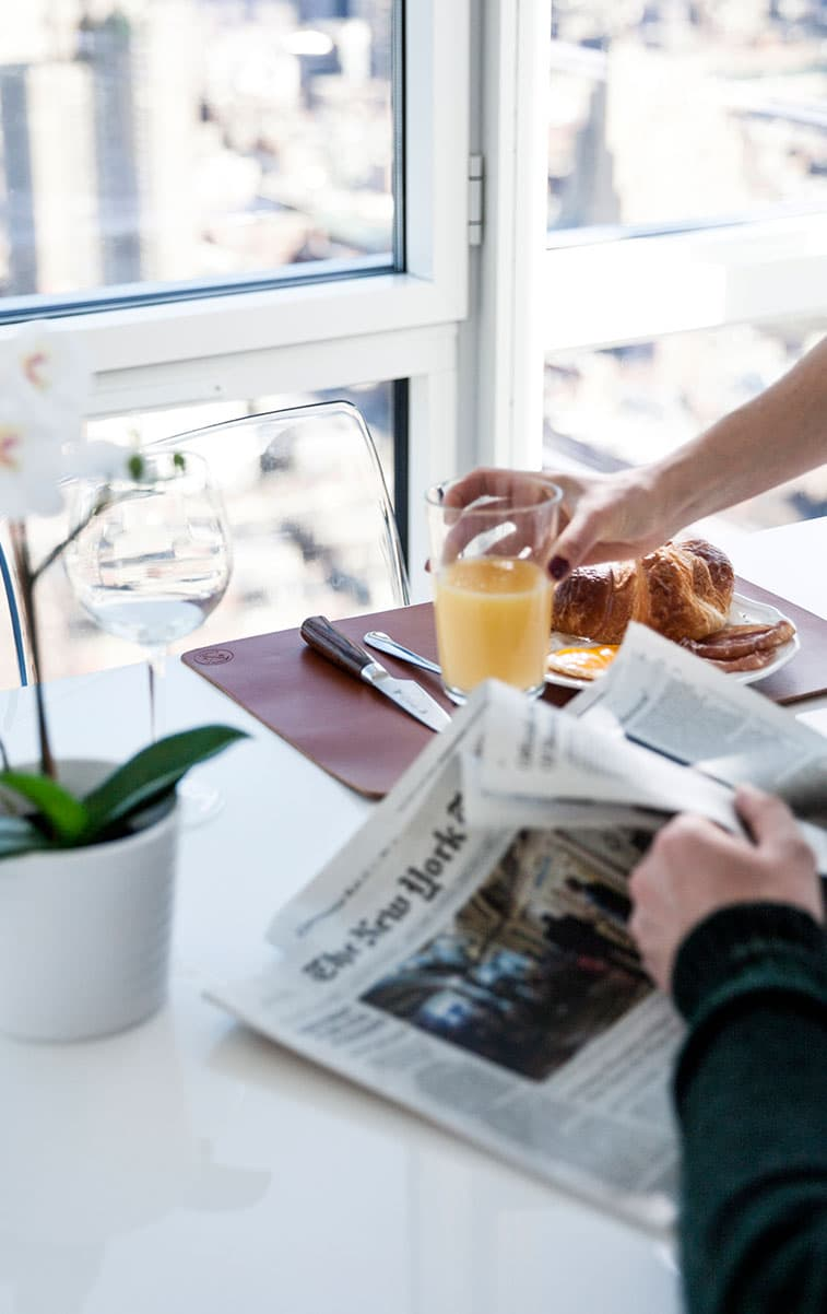 WITLOFT Penthouse in NYC Story breakfast table cognac placemat